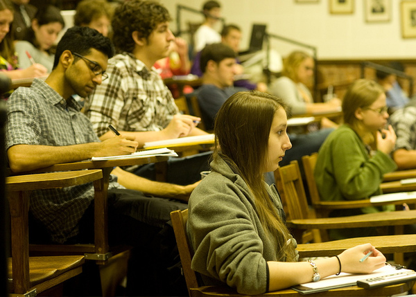Students take notes while attending a lecture, 2009.Photo: Ryan Muir